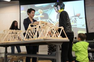 A student gets ready to test their bridge. (Photo by Ammon Swenson, Alaska Public Media- Anchorage)