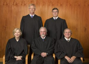 Alaska Supreme Court Justices Front Row (L-R): Senior Justice Dana A. Fabe (Ret.), Chief Justice Craig Stowers, Justice Daniel E. Winfree Back Row (L-R): Justice Peter J. Maassen, Justice Joel H. Bolger (Photo courtesy of the Alaska Court System)