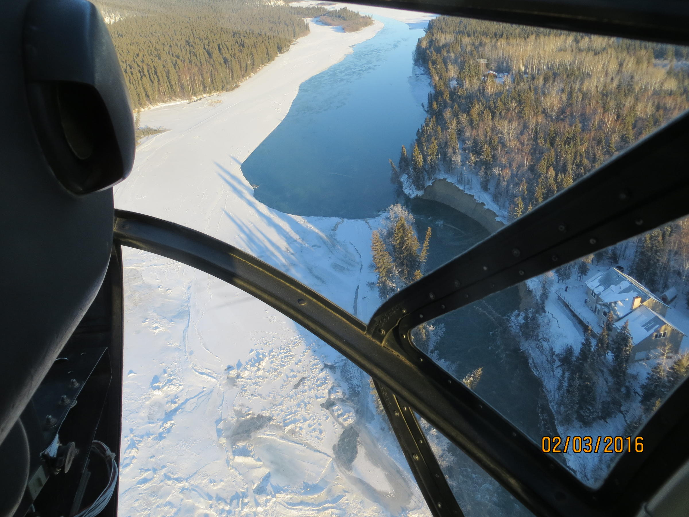 An aerial view showing how ice diverted much of the Tanana River into the small slough at the foot of the ridge on which Gorman built his home. (Photo courtesy of Tom Gorman)