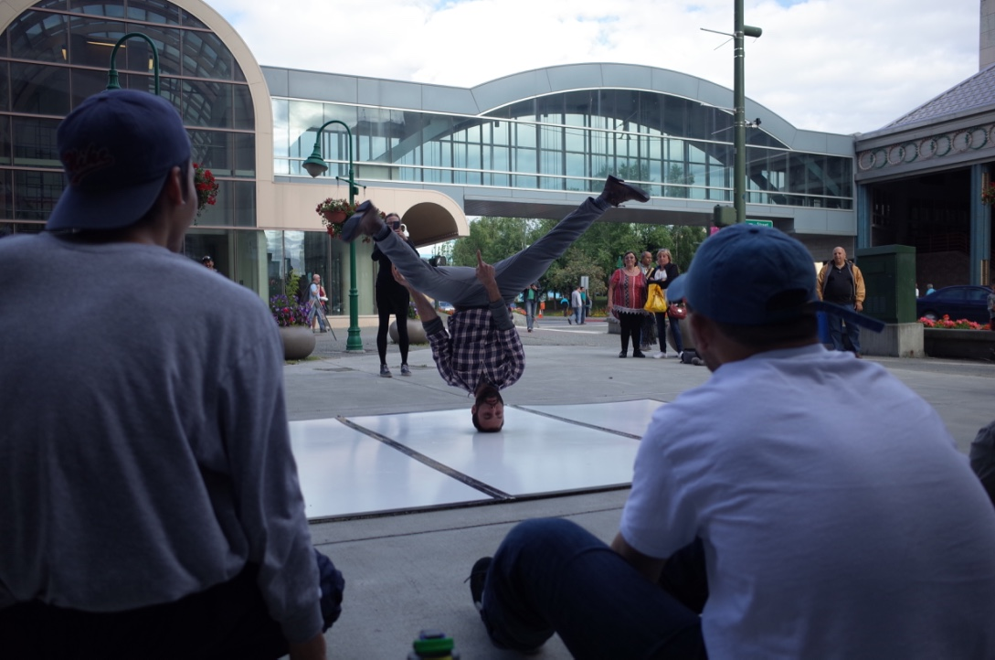 A spectator decides to join the breakdancers (Photo by Ammon Swenson, Alaska Public Media - Anchorage)