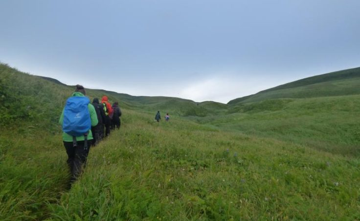 Youth Conservation Corps hike on Aiktek. (Photo by Zoe Sobel, Alaska's Energy Desk - Unalaska)