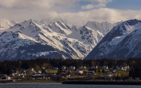 A cruiste ship pulls into a mountain town