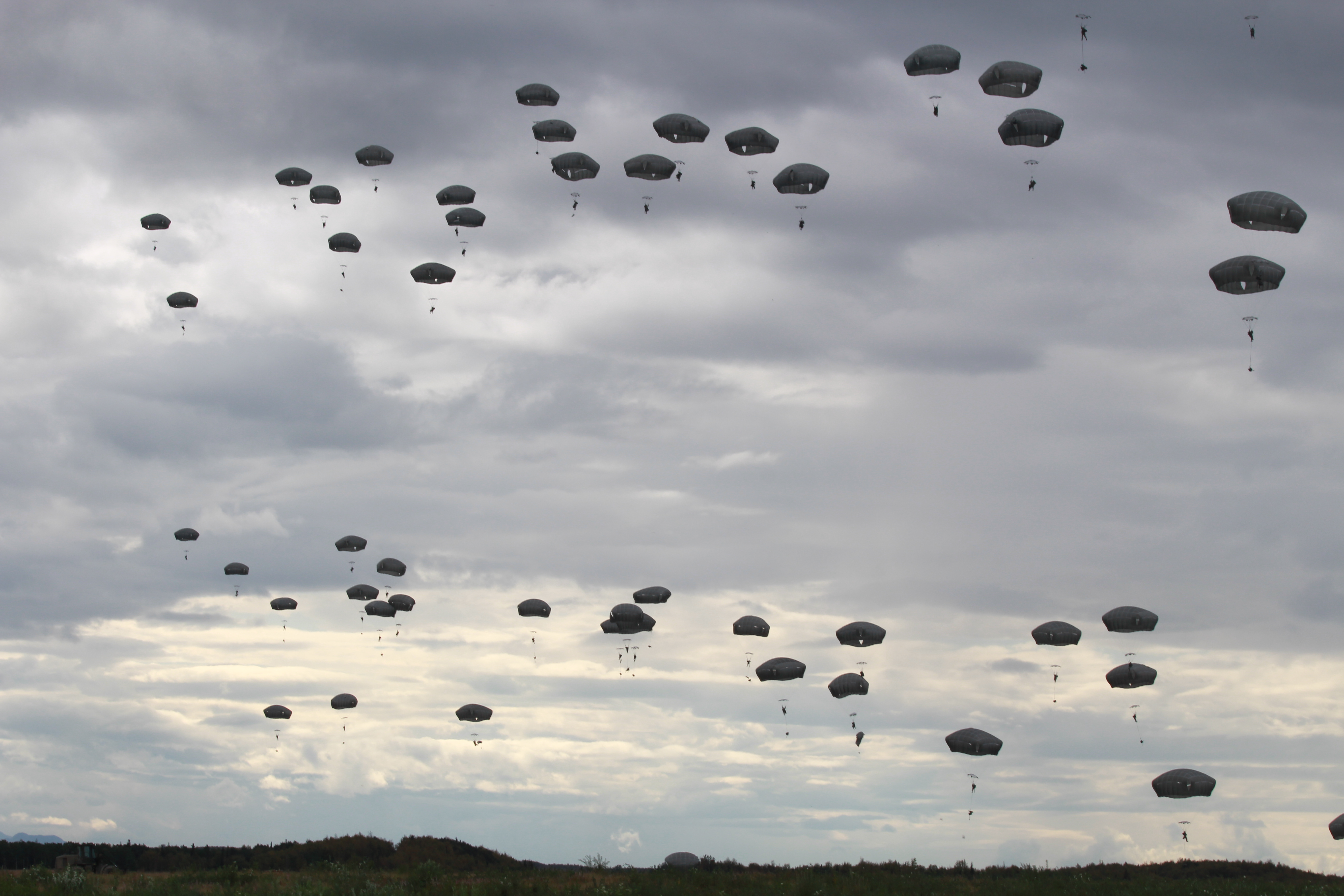Paratroopers dropping over Fort Richardson (Photo by Wesley Early, Alaska Public Media - Anchorage)