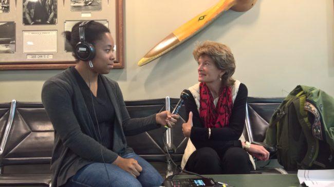 KTOO reporter Lakeidra Chavis interviews U.S. Sen. Lisa Murkowski at Juneau International Airport on Thursday. (Photo by Jeremy Hsieh, KTOO - Juneau)
