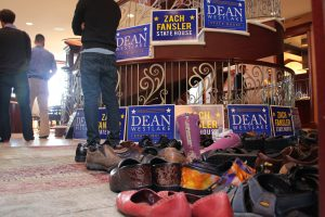Piles of shoes at the entrance to a Democratic fundraiser for Dean Westlake and Zach Fansler, at the home of oil and gas attorney Robin Brena. The fundraiser was co-hosted by nine House Democrats and former U.S. Senator Mark Begich, among other. Photo: Rachel Waldholz/Alaska's Energy Desk