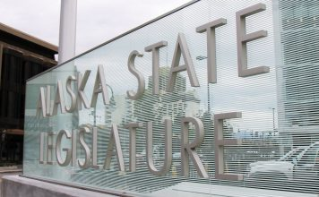The Alaska State Legislature sign at the Legislative Information Office in Downtown Anchorage.