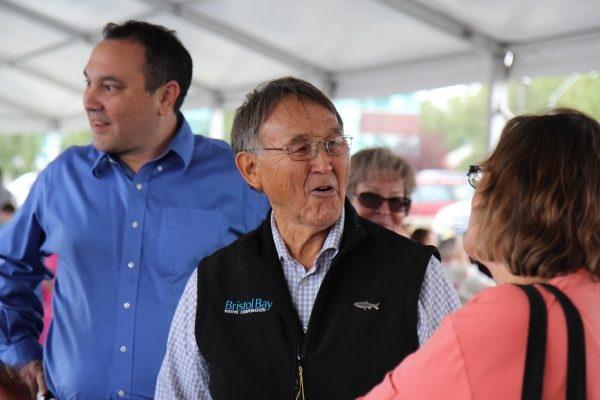 Joseph Chythlook talks with attendees at a community cookout hosted by the Bristol Bay Native Corporation celebrating Salmon Day in Anchorage on August 10. (Photo by Graelyn Brashear - KSKA/Anchorage)