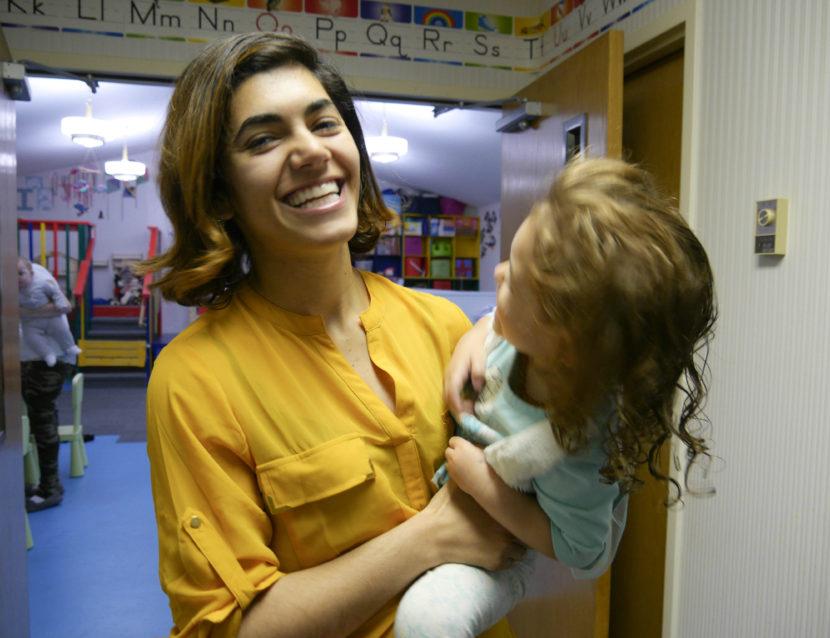 Issy Kako-Gehring holds her two-year-old daughter, Ally. Kako-Gehring runs the Gehring Nursery School in Juneau. (Photo by Lakeidra Chavis, KTOO - Juneau)
