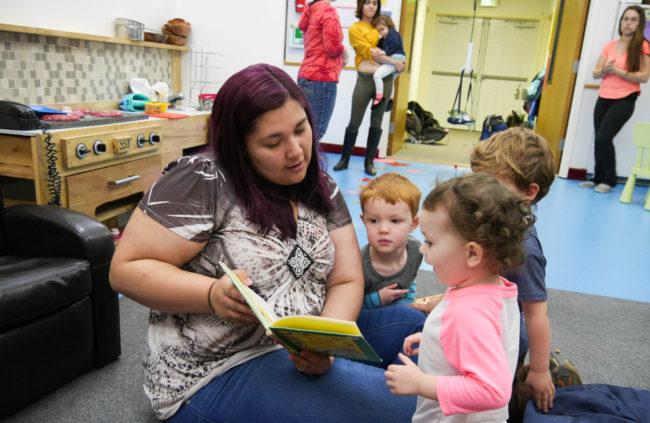 Gehring Nursery School worker Allison Cadiente-Laiti-Blattner reads to a group of children. (Photo by Lakeidra Chavis, KTOO - Juneau)