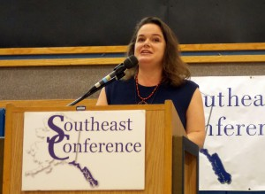 """Maelani Schijvens presents """"Southeast Alaska by the Numbers 2016″ to the Southeast Conference in Petersburg, Sept. 20. (Photo by Angela Denning, KFSK - Petersburg)"""