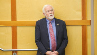University of Alaska Southeast Chancellor Rick Caulfield listens to President Jim Johnsen's presentation in the Egan Lecture Hall on Tuesday, Sept. 13, 2016. (Photo by Quinton Chandler, KTOO - Juneau)
