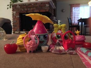 Rusty and Lola display a small portion of their Shopkins toys.