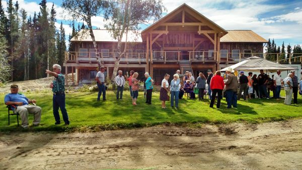 Even before owner Kevin Ewing opened the new Clearwater Lodge, dozens of area residents and visitors gathered in the back yard for a family celebration. The new facility opened Sept. 3. (Photo by Tim Ellis/KUAC)