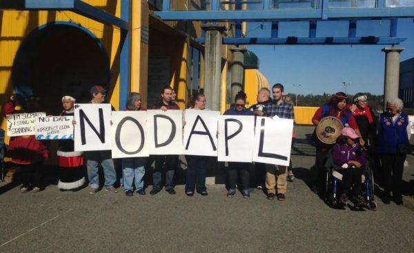 Demonstrators in downtown Anchorage protest the Dakota Access pipeline (photo by Elizabeth Harball/Alaska Public Media)
