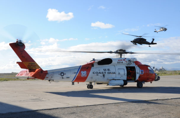A Coast Guard MH-60 Jayhawk rescue helicopter (foreground) in Kotzebue, Alaska, in August 2010. (Photo by Petty Officer 3rd Class Walter Shinn, U.S. Coast Guard)