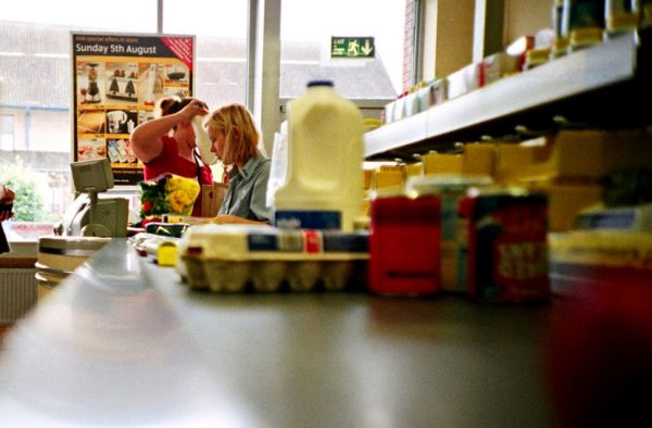 Essential groceries like milk and eggs slide down a conveyor belt to be purchased.