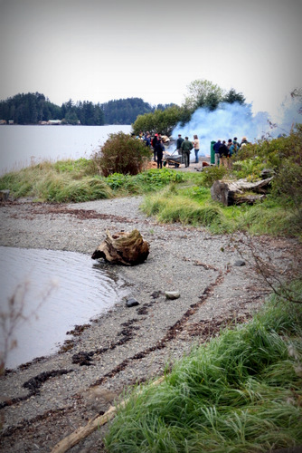 The steaming on Sitka's Eagle Beach attracted friends and family of the carvers along with Park Service employees. (Photo by Emily Russell, KCAW - Sitka)