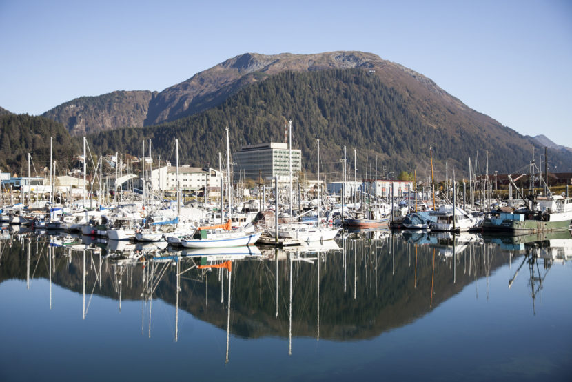 Boats lined up in Harris Harbor on a sunny, clear day Wednesday, Oct. 12, 2016 in downtown Juneau, Alaska. (Photo by Rashah McChesney, Alaska's Energy Desk - Juneau)