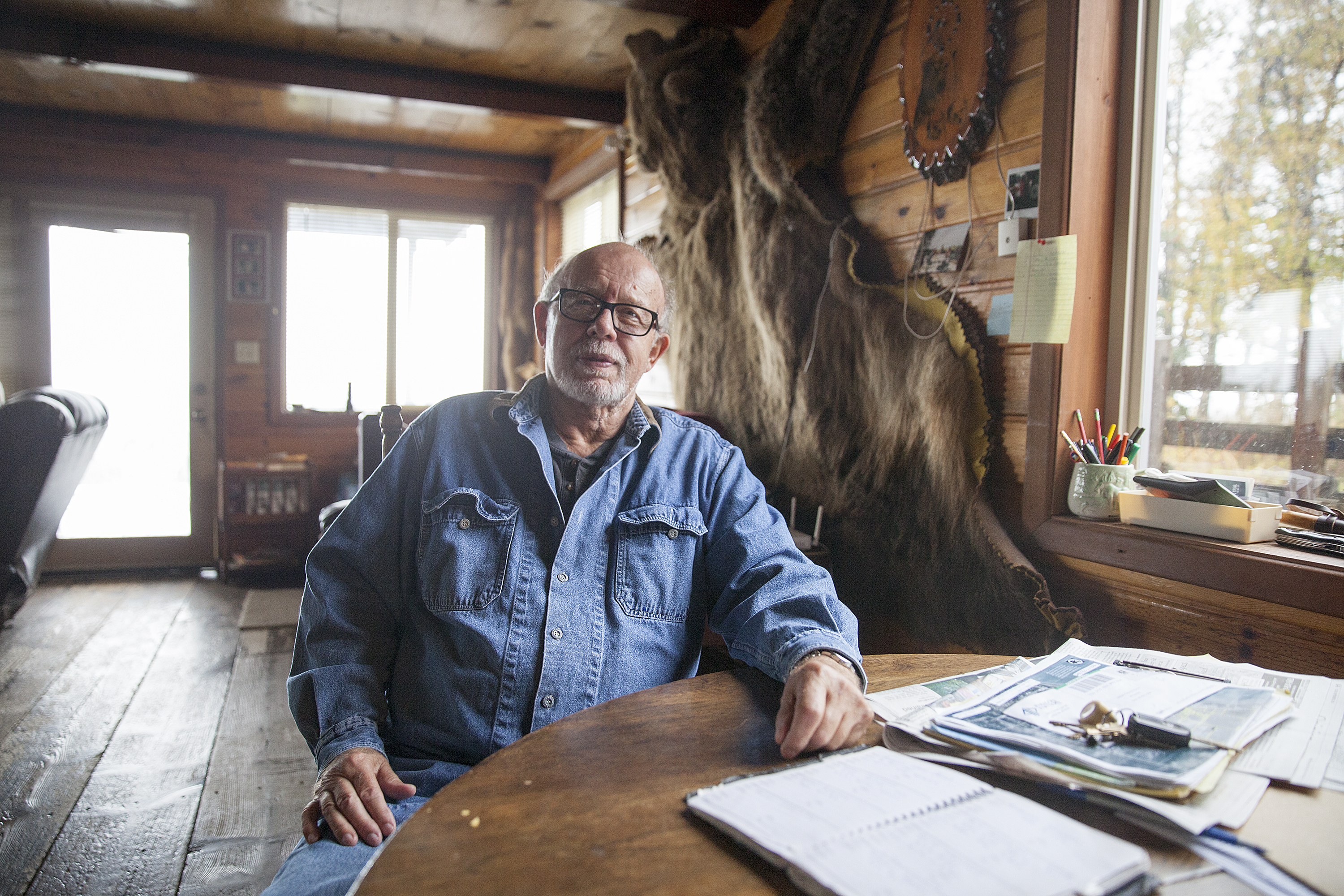 Bill Warren, in the home on land he says he was negotiating to sell to the Alaska LNG project on Sept. 25, 2016 in Nikiski, Alaska. Warren, and others in Nikiski, say they are unsure what will happen to their land as the project transitions to state control. (Photo by Rashah McChesney, Alaska's Energy Desk - Juneau)