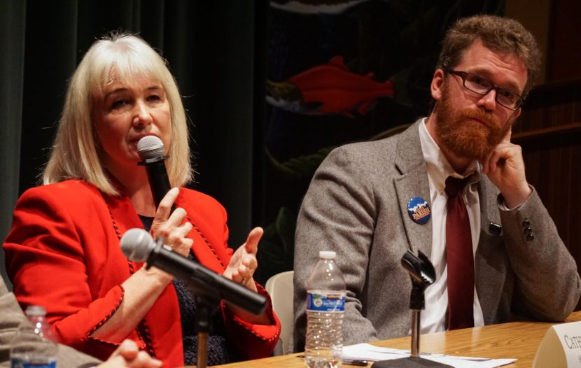 Republican Rep. Cathy Munoz answers a question at the Juneau Votes Statehouse Candidates Debate as her Democratic challenger Justin Parish listens at the Egan Lecture Hall at the University of Alaska Southeast, Oct. 13, 2016. (Photo by Jeremy Hsieh, KTOO - Juneau)