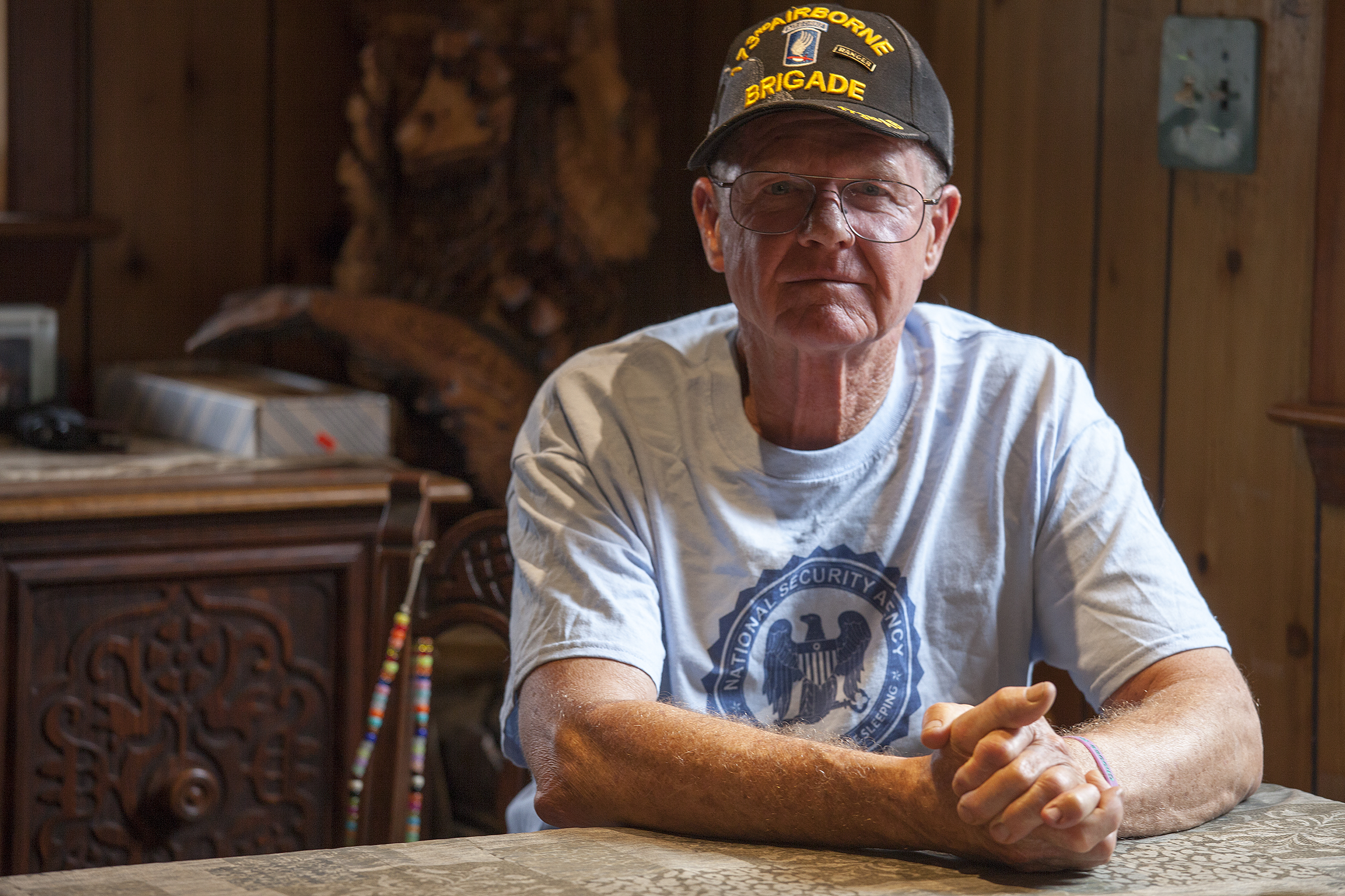John Suter sits in his dining room in Chugiak. His appeal with the Alaska Ombudsman's office has been ongoing for more than a decade. (Photo by Rashah McChesney, KTOO - Juneau)