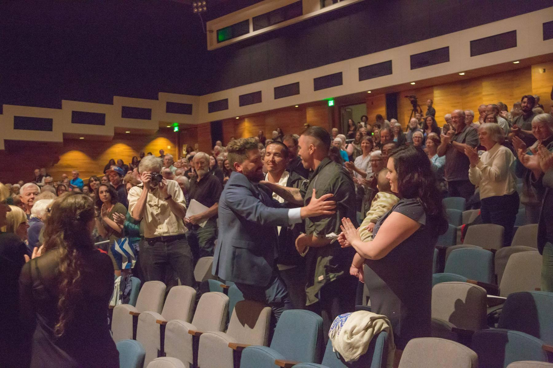 """Emerson Eads greets the Fairbanks Four and their family members after the """"Mass for the Oppressed"""" world premiere. (Photo courtesy of UAF)"""