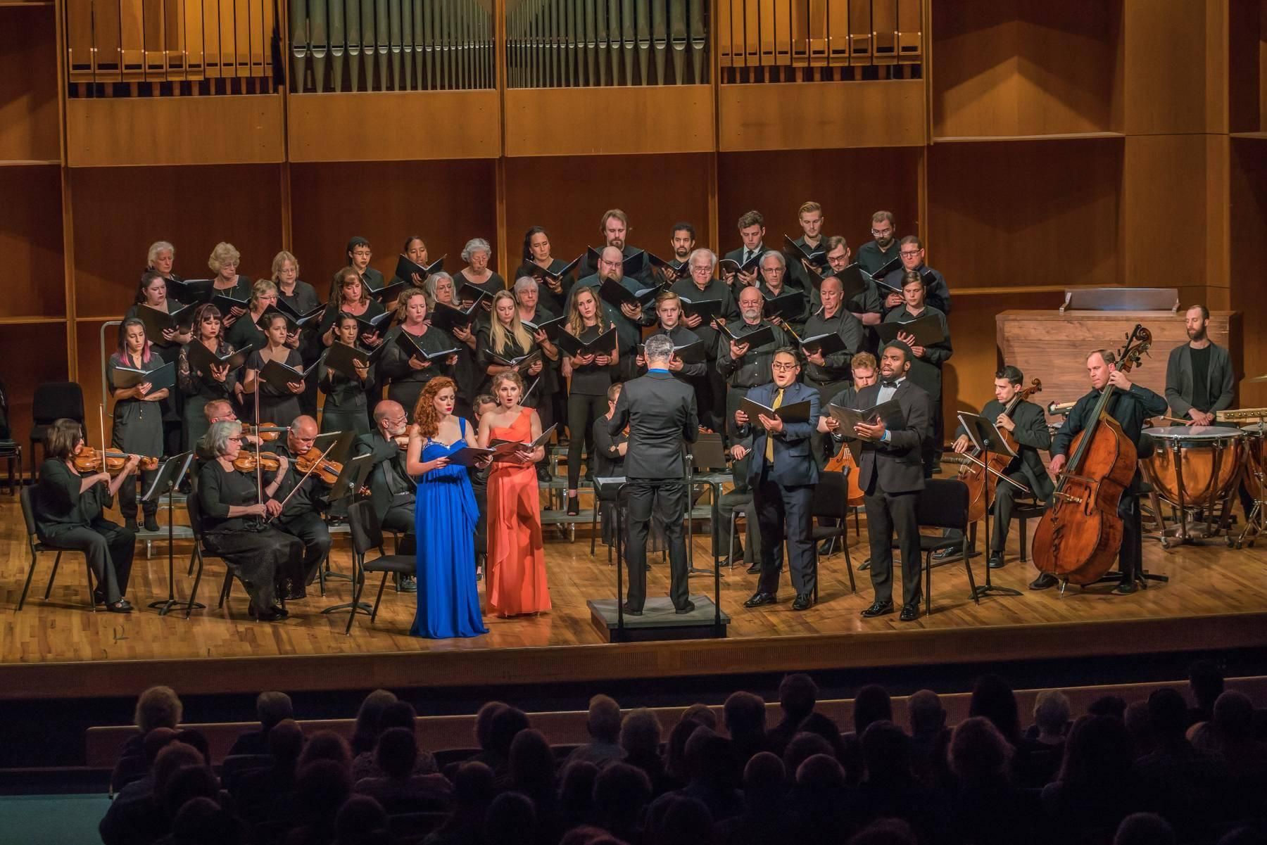 """Members of the Fairbanks Summer Arts Festival Symphony and Choir, conducted by Houston Symphony associate conductor Robert Franz, perform the world premiere of """"Mass for the Oppressed"""" on July 30 in the UAF Davis Concert Hall. (Photo courtesy of UAF)"""