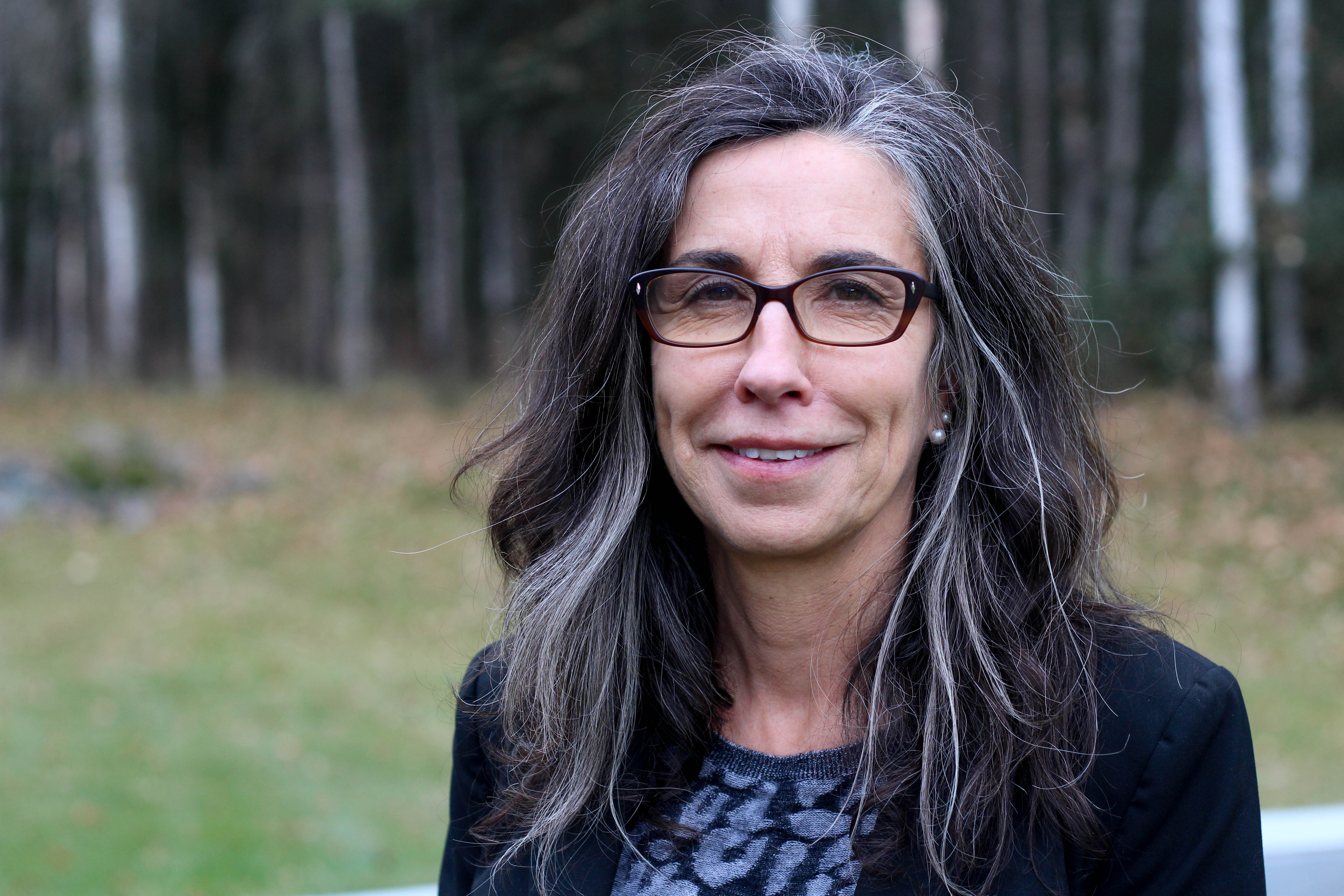 Marti Buscaglia is the new director of the Alaska State Commission for Human Rights. She took over the agency in May 2016. (Photo by Wesley Early, Alaska Public Media - Anchorage)