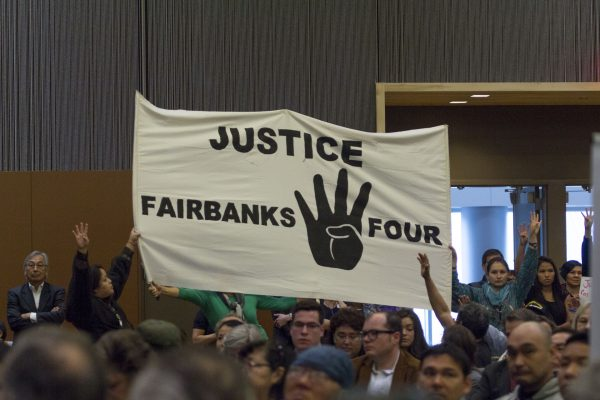 A Fairbanks Four banner at the 2015 Alaska Federation of Natives Conference. (Photo by Mikko Wilson/KTOO)
