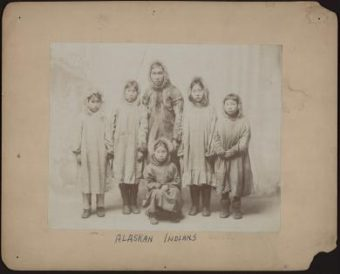 Handwritten on the back of this image: Pupils from Alaska AS THEY ARRIVED AT CARLISLE IN THE FALL OF 1897 SEE REDMAN, JUNE 1899. (Public Domain image from National Archives and Records Administration)