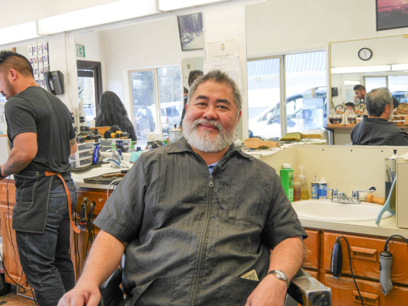 Gerry Carrillo Sr. sits in his barber's chair at at his barbershop. He's owned Gerry's Barbershop for nearly 30 years. (Photo by Lakeidra Chavis, KTOO - Juneau)