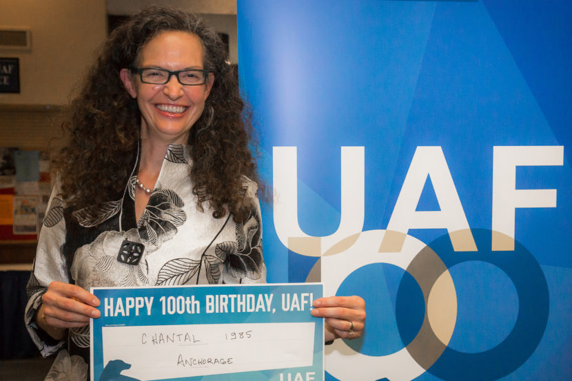 Chantal Walsh poses with a sign wishing the University of Alaska Fairbanks a happy 100th birthday, on Sept. 23, 2016, in Fairbanks, Alaska. Walsh has just been named as the director of the Department of Natural Resources Oil and Gas division. (Photo courtesy JR Ancheta/University of Alaska Fairbanks)