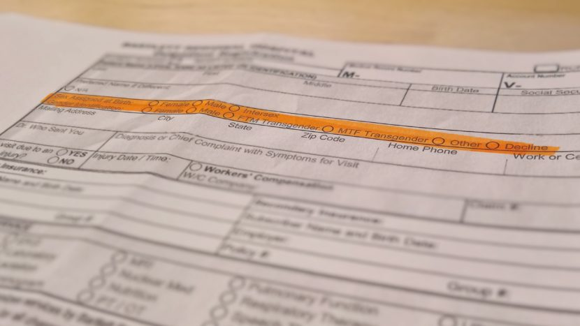 A copy of Bartlett Regional Hospital's new outpatient registration form asks for sex assigned at birth and gender identification with expanded options. (Photo illustration by Jeremy Hsieh, KTOO - Juneau)