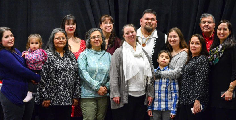 Alfie Price, sixth from the right, poses with family and friends after he was honored as a language warrior during a Nov. 22, 2016, awards ceremony. (Photo courtesy Central Council of Tlingit and Haida Indian Tribes of Alaska)
