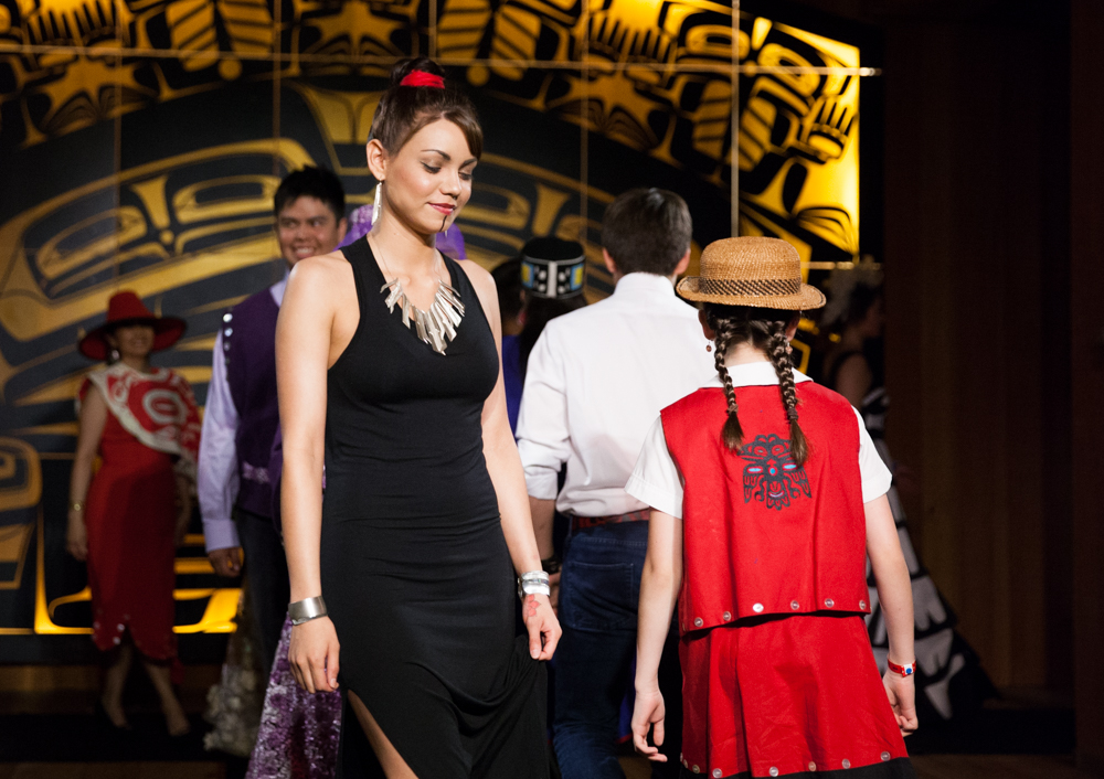 During Celebration this June, Sealaska Heritage Institute sponsored a fashion show, featuring the work of 18 designers. Here, Camille Mauch models jewelry by Rico Worl. (Annie Bartholomew/KTOO photo)