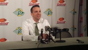 UAA Head Coach Ryan McCarthy speaks at a post-game press conference during the 2016 Great Alaska Shootout. (Photo by Josh Edge/APRN)
