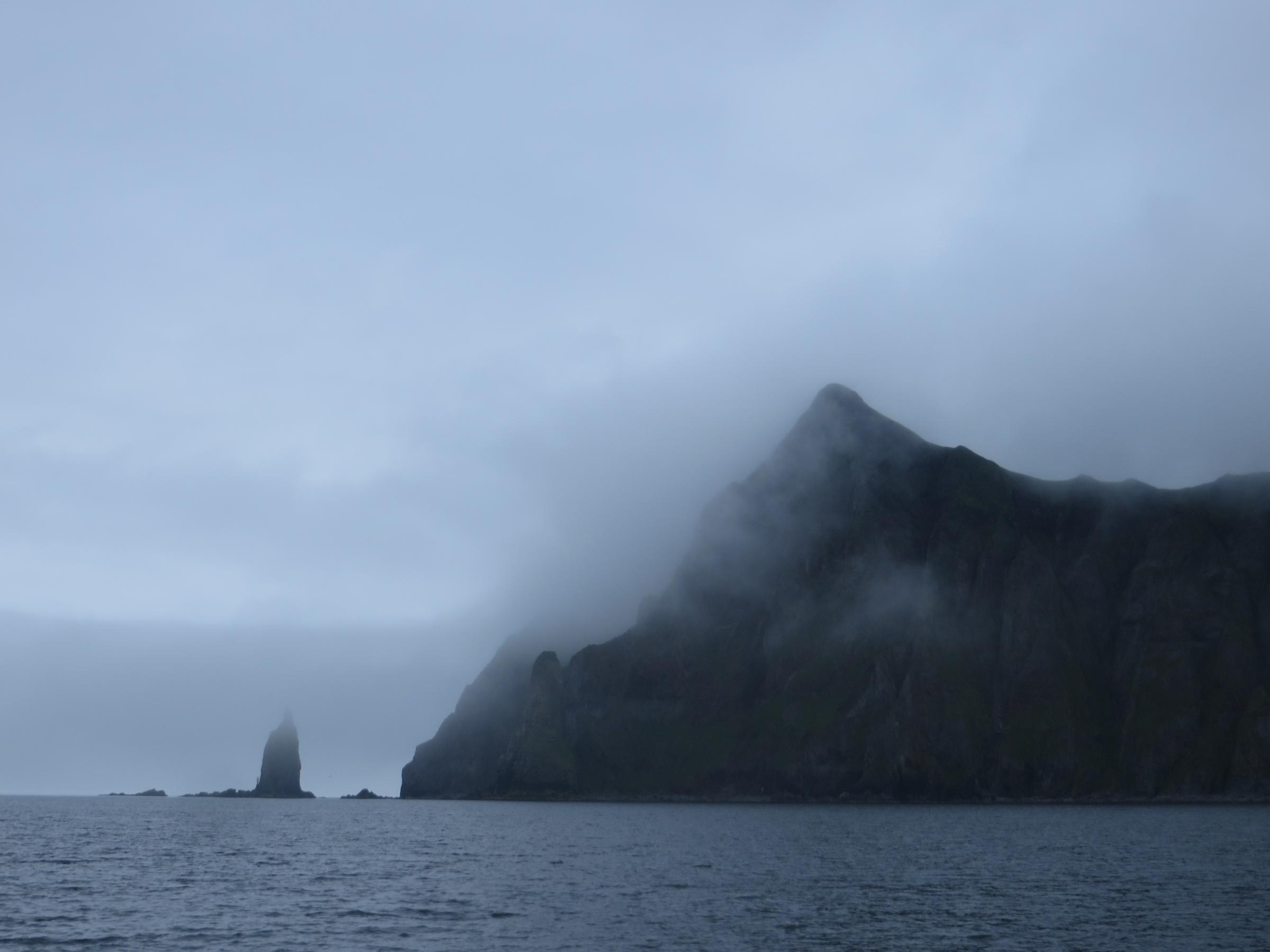 Priest Rock on a foggy day in July. (Laura Kraegel, KUCB - Unalaska)