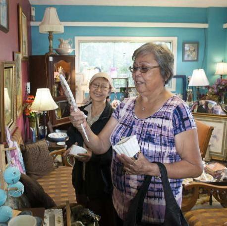 Nancy Nelson (left) and Laura Hobson (right) browse in a local antiques store. The two spend several hours together each week as part of the Kenaitze Senior Companion Program. (Photo courtesy of Kenaitze Indian Tribe)
