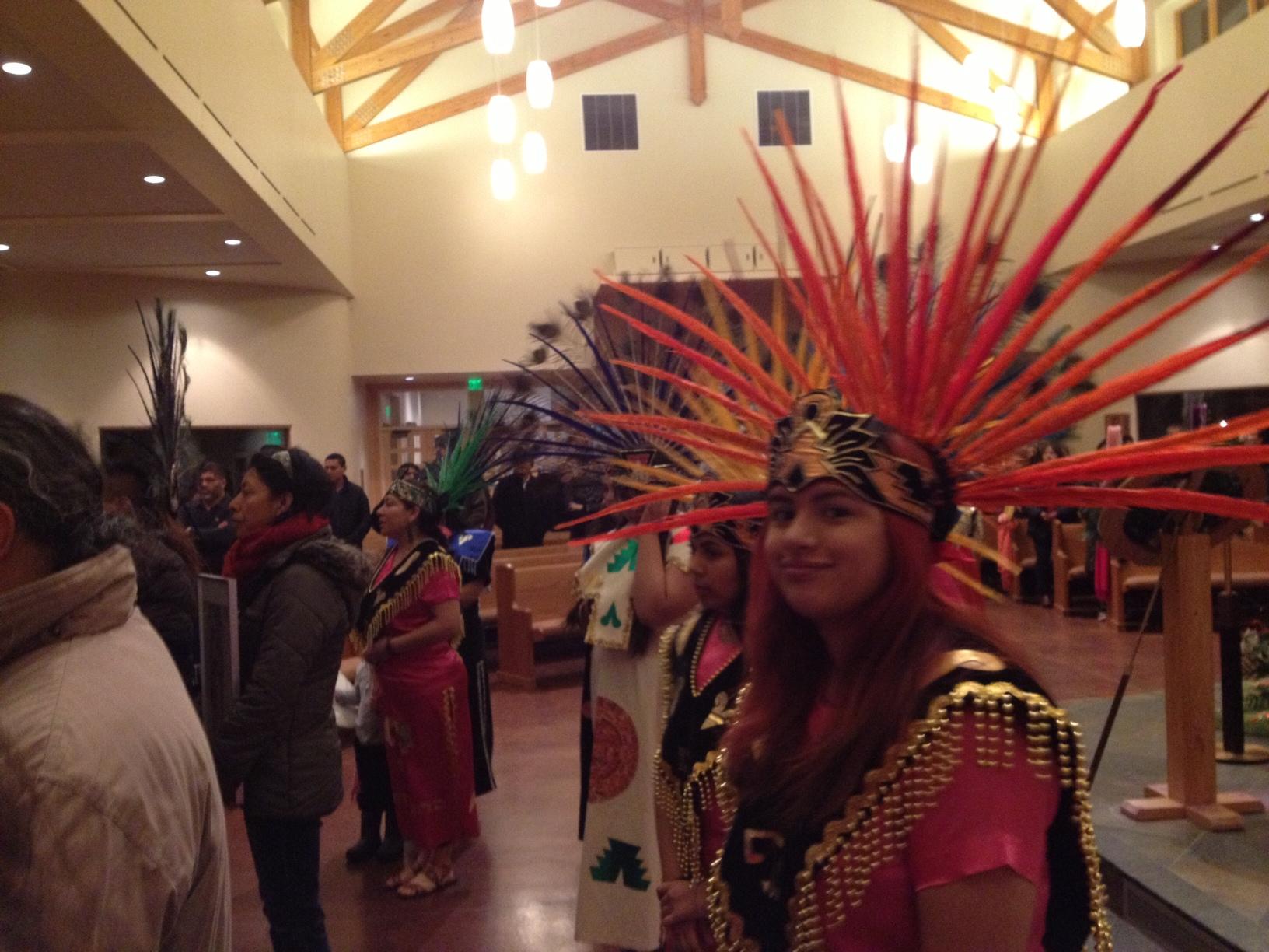 Aztec dancers at the celebration of La Senora de Guadalupe. (Photo by Ellen Lockyer - Alaska Public Media.