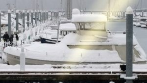 Boats in Seward's harbor are covered in snow after the community received more than two feet over the weekend. (Photo courtesy the City of Seward)