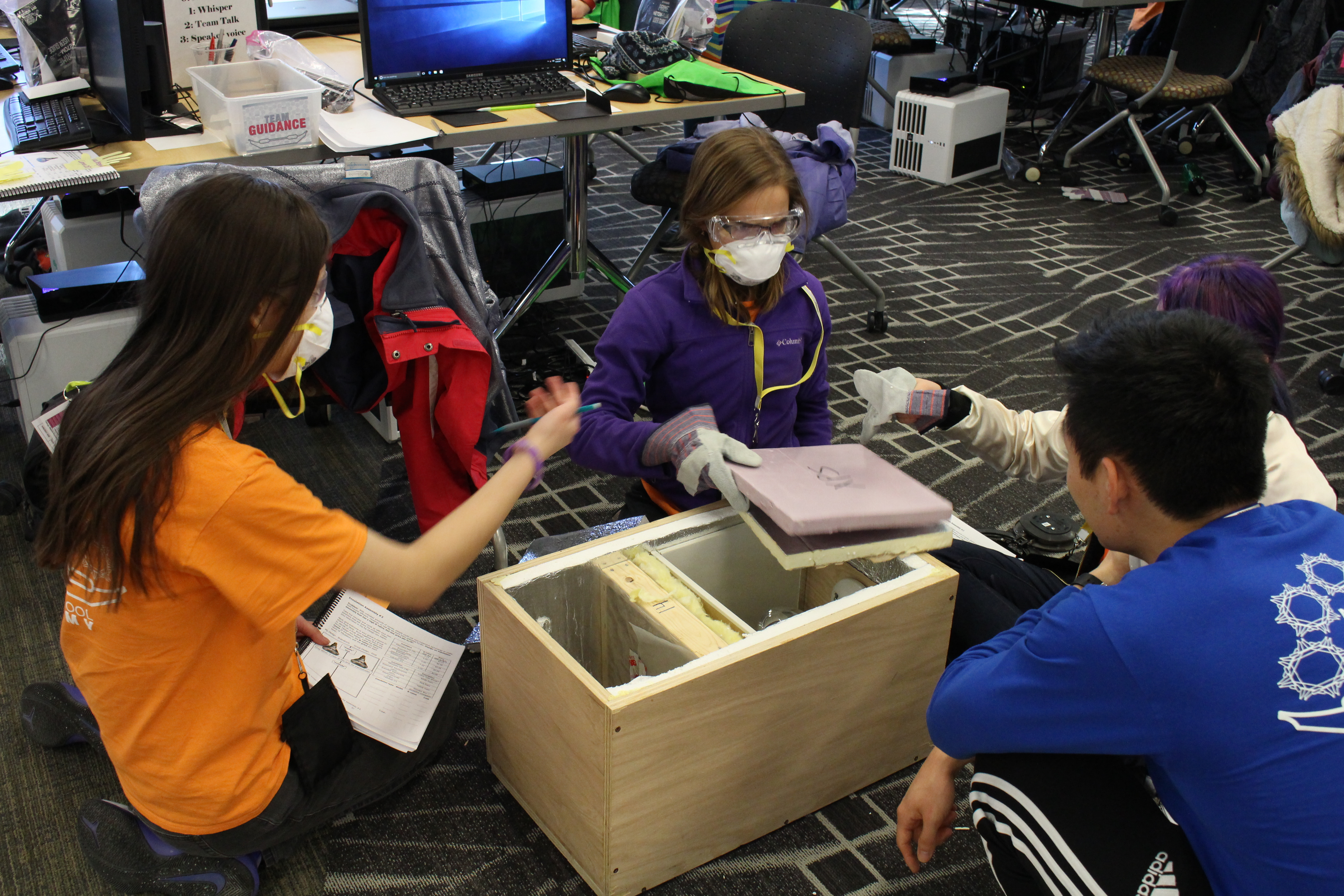 SStudents work on a box