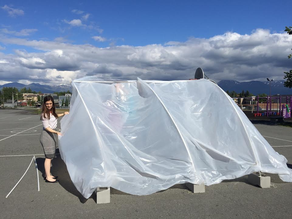 Participants in the refugee c& simulation try to build a shelter with tarps and PVC pipes at Chugach Optional School in Anchorage on June 14 2017. & Learning about life in a refugee camp | Alaska Public Media