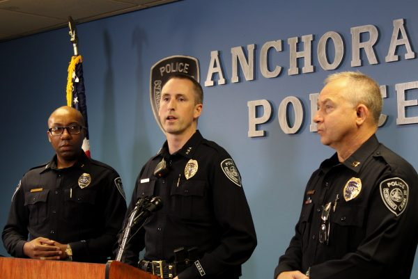 A white man in an officers uniform speaks at a podium