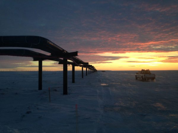 A pipeline stretching toward a sunset