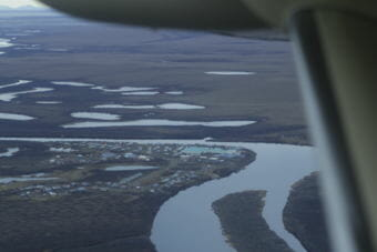 a river with a small town on the oxbow as seen from an airpllane.