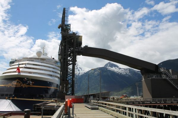 The Disney Wonder cruise ship docks near the ship loader at Skagway's ore terminal. (Photo by Henry Leasia, KHNS - Haines)
