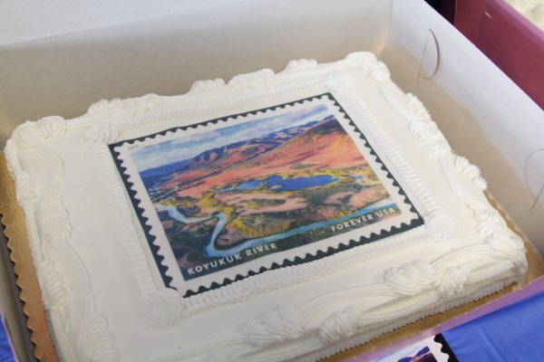 A cake features a print of the Koyukuk River at a USPS and NPS celebration of the stamps on May 29.