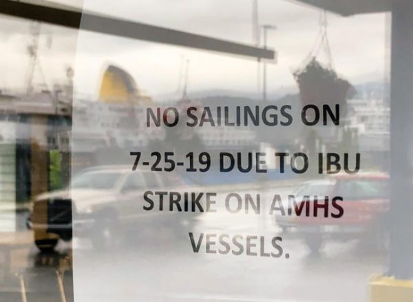 State warns striking ferry workers of loss of health coverage