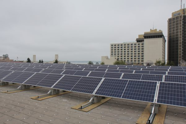 Anchorage mayor unveils municipality's first, state's largest, solar project on Egan Center rooftop