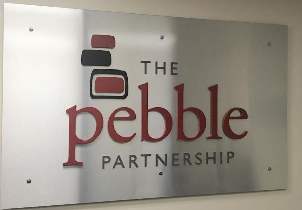 "A silver sign that says ""The Pebble Partnership"""